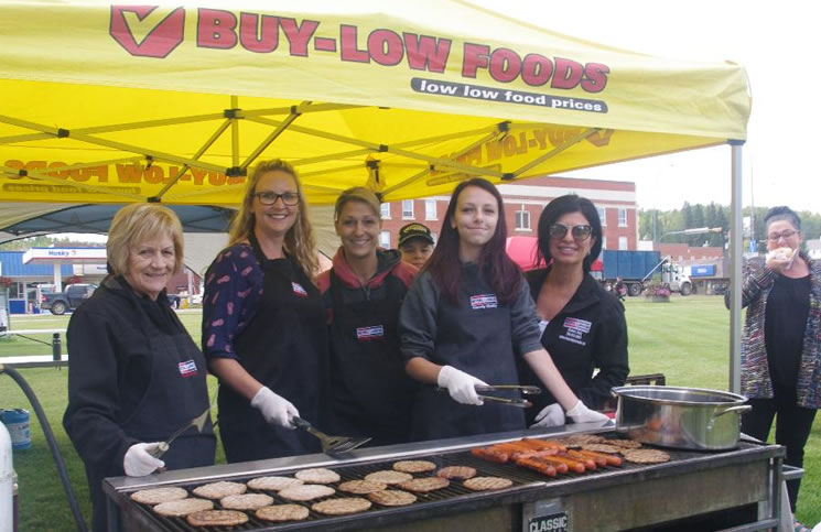 Volunteers from Royal LePage County Realty prepare the barbecue lunch at Walk A Mile in Her Shoes in Athabasca, Alta. From left: Betty Kanuga, RaDell Bennett-Chrusch, Jennifer Miller, Mya Bennett-Chrusch and Shahira Bury.