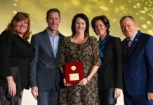 From left: Tami Bonnell, Exit Realty CEO; Craig Witt, president, U.S. Division; Julie Jenkins; Joyce Paron, president, Canadian Division; and founder and chairman Steve Morris.