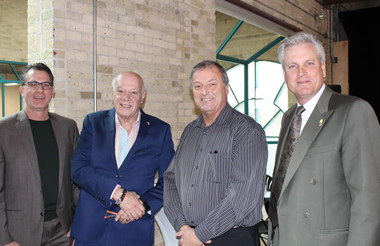 Attending the Tip Mitawa opening, from left: Rob Hutchison, Realtor; Lorne Weiss, chair of the MREA Political Action Committee; Ralph Fyfe, past president of MREA; and David Powell, MREA president.