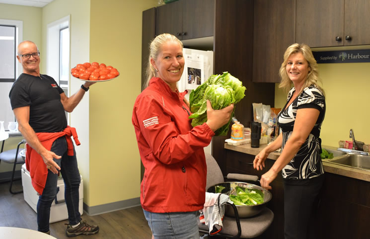 Royal LePage sales representative prepare lunch for the hungry riders in the Petite Fondo. From left: Rob Phillips, Amanda Van Delft and Antonietta Gaudet