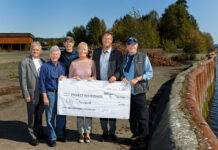 Dave Procter, second from right, and Janine Martin present a cheque to Project Watershed.