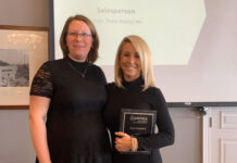 Kate Broddick was presented with the award by Felicia Finnigan, left, CEO of the Brantford Real Estate Association.