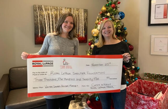 Kelly Renee Kaye and Cathy Svendsen of Royal LePage Frank Real Estate present funds raised for the Royal LePage Shelter Foundation at their second annual Whitby Shores Holiday Market.