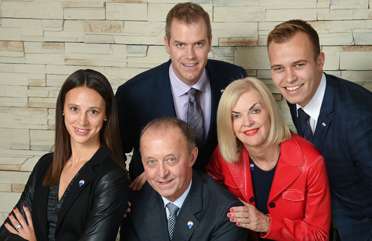Re/Max Integra was launched 40 years ago and continues to be a family affair. From left: Shelby Schneider, VP of corporate synergy; Walter Schneider, founder and president; Christopher Alexander, EVP; Pamela Alexander, CEO; and Simon Schneider, franchise sales consultant. Not present for the photo shoot was Frank Polzler, founder and chairman and Michael Polzler, CEO and managing director, Europe. (Photos: Elijah Shark)
