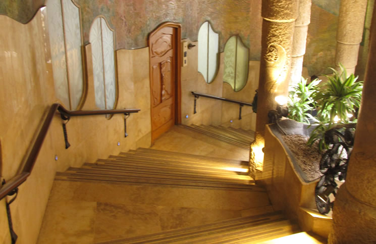 This staircase includes painted scenes, carved columns and a view onto an inner courtyard.