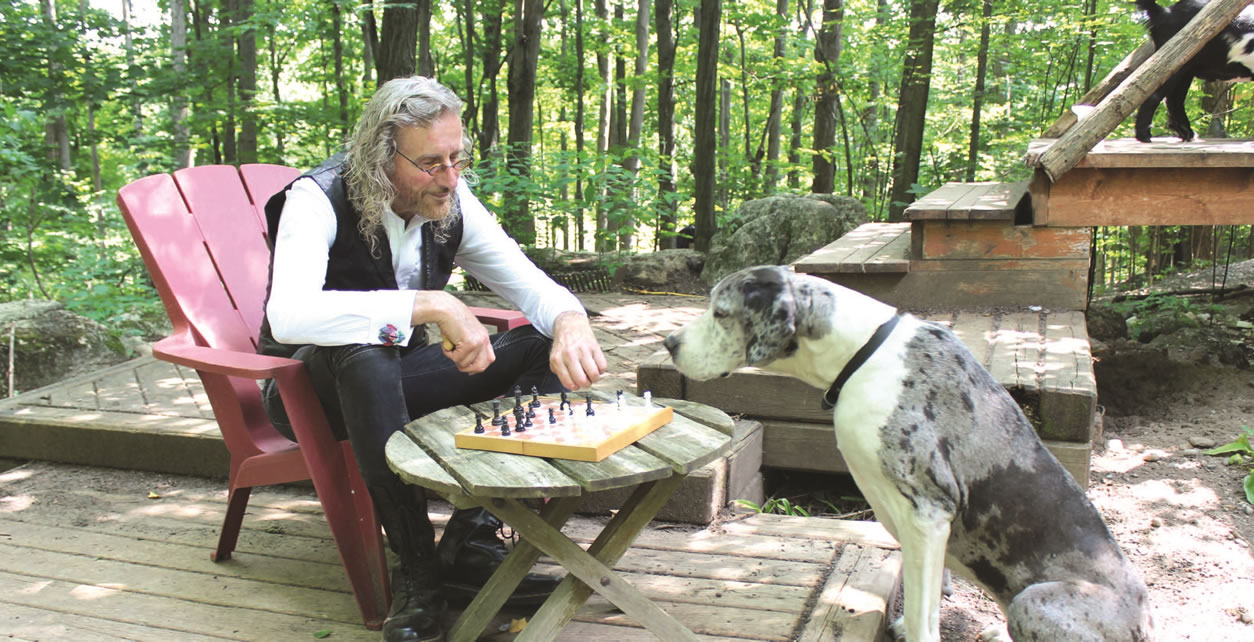 Wayne Baguley with his chess-playing Great Dane.
