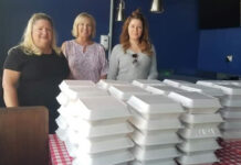 Getting ready to deliver meals, from left: Cindy Haggerty, Maureen Blackstock and Carlie McCaughen.