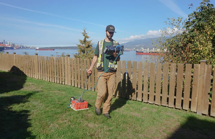 A technician performing a GPR scan for a buried oil tank (Photo: GeoScan).