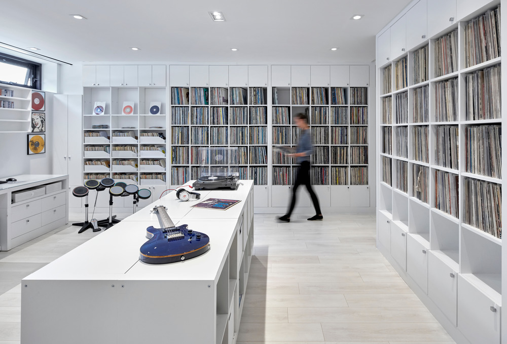 Part music library, part office, this room artfully showcases the owners' impressive vinyl record collection.