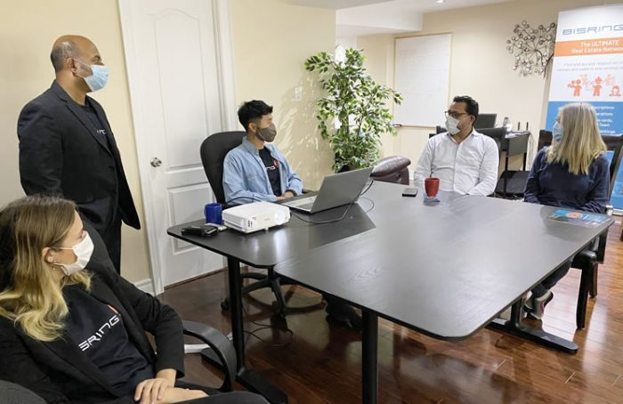 BisRing founder and CEO Akilan Theva (standing, left) and his staff recently met with Richmond Hill MP Majid Jowhari to show off the network.
