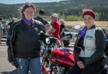 """Enjoying the """"Cruz 4 Her"""" fundraising ride are Tara McFadden of the Big Hill Haven Women's Shelter and Debbie Leah, sales representative with Royal LePage Allstar. (Photo: Jacquie Matechuk Photography)"""