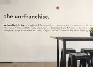 "TrillumWest's ""un-franchise"" motto is painted on their wall."