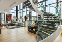 Access to the second level is via a stunning glass-and-steel staircase or private elevator.