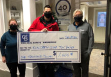 Rhonda White and Paul Orchard present a cheque to Keith McDonald of the Kinsmen Club on behalf of agents in the Lindsay and Bobcaygeon offices.