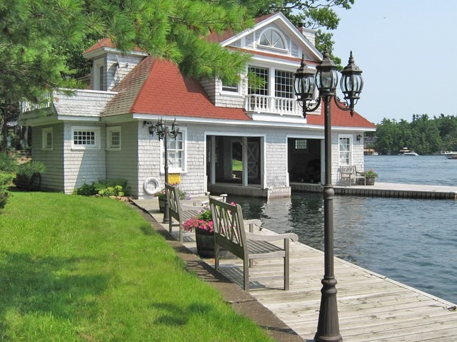 The second floor of the boathouse is a guest cabin.
