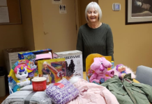 Maureen Ruscheinsky with toys and clothes for the family.
