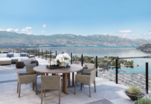 The penthouse has 2,600 square feet of exterior living space with a fully equipped chef's kitchen and panoramic lake views.