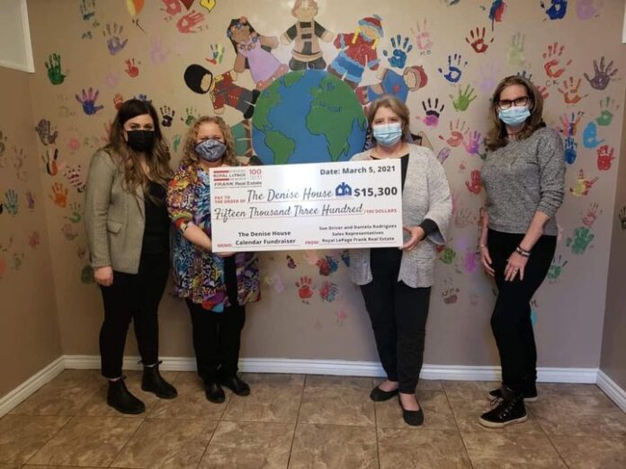 Daniela Rodrigues and Sue Driver present the cheque to representatives of The Denise House.