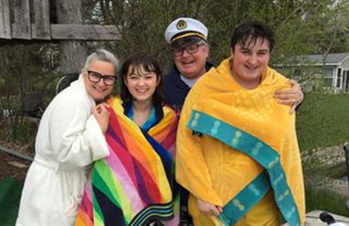 Realtors Jennifer Bacon and Dean Michel with their teenagers Bronwyn and Finn after their chilly plunge.