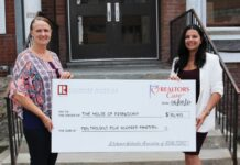Margaret Lucas accepts the cheque from KWAR president Nicole Pohl.