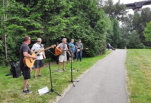 Graham Newberry and friends perform in a Surrey park.