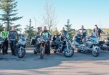 Ken Morris, far right, with his Ride for Shelter friends and fundraisers in Cochrane, Alta.