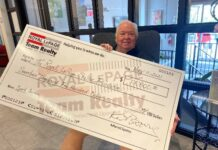 Kent Browne shows off a cheque for $17,500 that was raised for the Royal LePage Shelter Foundation via his virtual auction of sports memorabilia.