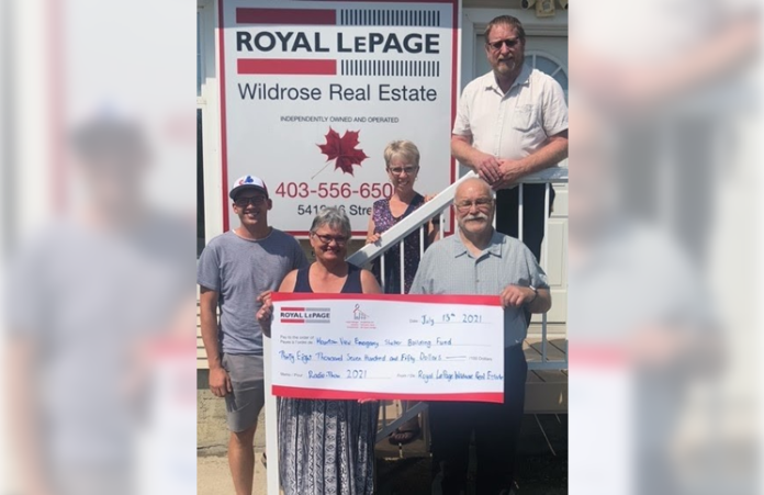 From left: Bernd Van't Klooster, creative director, Cab-K Broadcasting; Clare Dickie, owner/manager, Royal LePage Wildrose Real Estate; Debbi Rempel from The Travel Agent Next Door; Joe Carignan, president, Mountain View Emergency Shelter Society; and Merrell Dickie, broker/owner, Royal LePage Wildrose Real Estate.