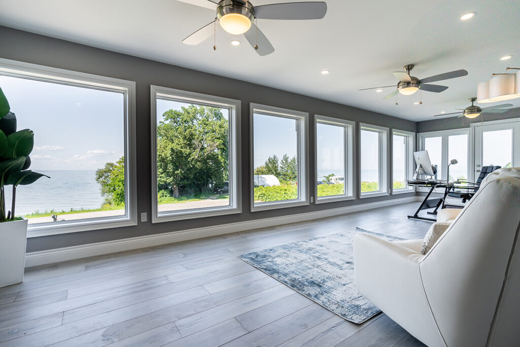 The upper level of the home boasts a huge lakefront office plus four bedrooms.
