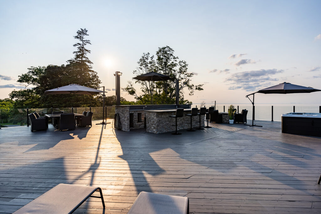 A 2,000-square-foot rooftop deck has a kitchen, a hot tub, a fire table and lake and vineyard views.