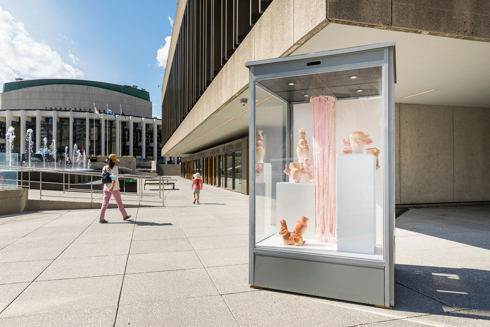 Ten glass cubes are deployed across the city presenting works of art to the general public.
