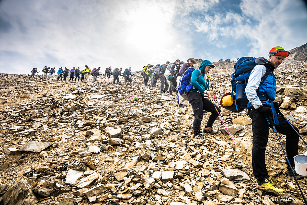 Purcell Mountains Challenge for Shelter trekkers hike cautiously down a mountain of shale. Photo: Sebastian Albrecht