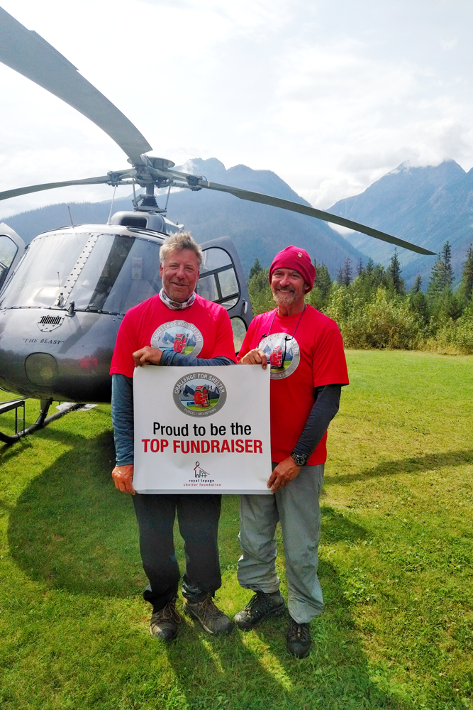 Chris Pennycook (left), the top fundraiser, arrives back from the adventure with fellow trekker and Royal LePage president and CEO, Phil Soper. Photo: Carly Neill
